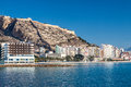 Alicante coastline and buildings with hotels santa barbara castle in background Stock Images