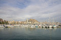 Alicante harbor november on november spain view of harbour with yachts and castle of santa barbara in background at Royalty Free Stock Photos
