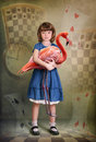Alice and flamingo Royalty Free Stock Photo