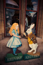 Alice and the white rabbit alice s shop oxford england september two cardboard cut out signs advertise at a street of england this Royalty Free Stock Images