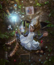 Alice in wonderland falls down the rabbit hole with a can their hands Royalty Free Stock Photo