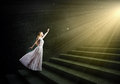 Alice in wonderland young woman white long dress stepping up the staircase Stock Photography
