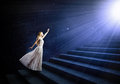 Alice in wonderland young woman white long dress stepping up the staircase Royalty Free Stock Images