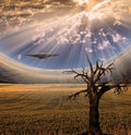 Alien craft in landscape with clouds and sun Stock Photos