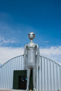 Alien figure stands guard in rachel nevada usa – march the tall metal at the research center located on s extraterrestrial Stock Image