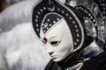 Alien schwaebisch hall germany february woman dressed up in a venetian style costume with an like face mask attends the hallia Stock Image