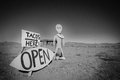 Alien and a taco shop sign on the way to the black rock desert in nevada black white pitcure Stock Images