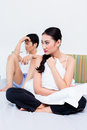 Alienated Chinese couple, woman is rejecting her man Royalty Free Stock Photo