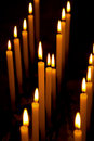 Alight candles over the black background Stock Photo