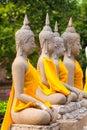 Aligned buddha statues at Wat Yai Chaimongkol Ayutthaya bangkok thailand Royalty Free Stock Photo