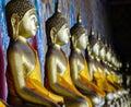 Aligned gold buddha Royalty Free Stock Photo