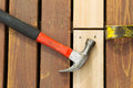 Aligning New Wood into Cedar Deck Royalty Free Stock Photo