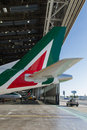 Alitalia airplaine tail inside hangar ready for maintenance Stock Images