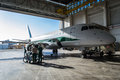 Alitalia embraer in hangar modern airplane the back view maintenance specialist are ready to repair the airplane frontal view Stock Images