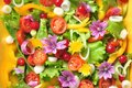 Alkaline, colorful salad with flowers, fruit and vegetables Royalty Free Stock Photo