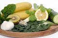Alkaline diet a wooden tray with vegetables and fruits banana kiwi spinach lemon cucumber parsley silver beat and garlic Stock Photography