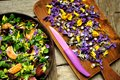 Alkaline, healthy food: salad with flowers, fruit and valerian salad Royalty Free Stock Photo