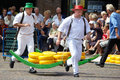Alkmaar, the Netherlands - August 14, 2009: Cheese carriers are displacing cheese with a show in the traditional cheese market in