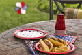 All american hotdogs at a cookout holiday and picnic complete with and potato chips one image in series of patriotically themed Royalty Free Stock Photos