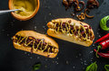 All beef hotdogs delicious full of meat with caramelized red onion french mustard and chilli dogs Stock Photos