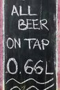 All beer on tap the inscription is chalked on a black board of a