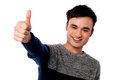 All the best smart young guy showing thumbs up gesture Stock Images