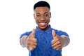 All the best work hard do well smart young man showing double thumbs up Stock Images