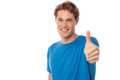 All the best work hard do well smart young man showing thumbs up Stock Photography
