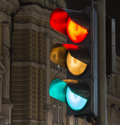 All the colors of a traffic light in ljubljana at night with lit should i go or should i wait Royalty Free Stock Image