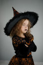 Preparation for Halloween. Cute girl 8-9 years in image the evil fairy.
