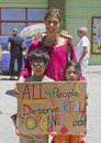All people deserve organic food asheville north carolina usa may a mother and two children hold a handmade sign saying that at an Stock Photo