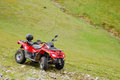 All terrain vehicle in the mountains Stock Images
