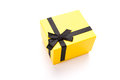 All tied uo yellow gift box with black ribbon on white background Stock Photography