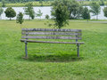 All you need is love a park bench with the words written on it Royalty Free Stock Photo