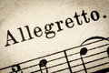 Allegretto fast music tempo quickly and bright close to but not quite allegro macro detail from vintage sheet Stock Images