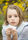 Allergic rhinitis have a little girl blowing nose Royalty Free Stock Photo