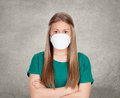 Allergic teen with face mask on gray background Royalty Free Stock Photo