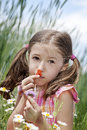 Allergic to pollen unhappy girl because she love flowers but is Royalty Free Stock Image