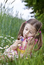 Allergic to pollen unhappy girl because she love flowers but is Stock Images