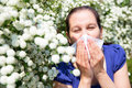 Allergic woman sneezing in handkerchief pollen allergy Royalty Free Stock Photography
