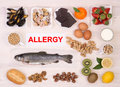 Allergy causing foods often on white wooden table top view Stock Images