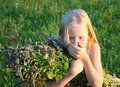 Allergy little blonde girl with mint sneezes Royalty Free Stock Photography
