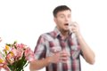Allergy man blowing his nose in tissue paper isolated on white background Stock Image