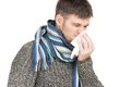 Allergy man blowing his nose in tissue paper isolated on white background Stock Photos