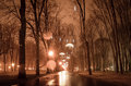 Alley in Kharkiv park with night lights. Photo in vintage multicolor style. Royalty Free Stock Photo