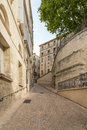 Alley with Old Limestone Houses and Windows, Montpelier, France Royalty Free Stock Photo