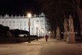 Alley and statues near majestic royal palace at night in madrid spain Stock Photos