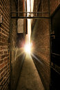 Alley to light mysterious narrow with at the end Stock Photography