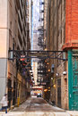 Alleyway in Chicago with pedestrian passing by Royalty Free Stock Photo