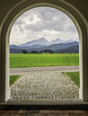 Allgau mountains in fussen picture of feet from a doorway of a church near bavaria germany Royalty Free Stock Photography
